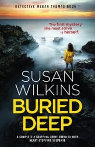 Image of the cover of Buried Deep by Susan Wilkins featuring a misty sea with a rocky shoreline and a female figure standing on the rocks looking out to sea